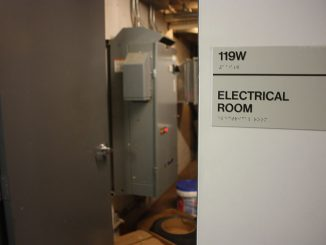 Mechanics worked to repair damage in an electrical room inside Temple Towers after a steam pipe burst, causing a power outage in the building in the early morning hours on Saturday.   John Moritz TTN