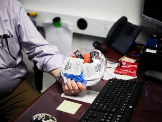 Joseph Alkus, a criminal justice instructor, holds Narcan, a medication that temporarily reverses the effects of an opioid overdose, in his office on Jan. 16. Alkus began carrying Narcan last semester. | HANNAH BURNS / THE TEMPLE NEWS