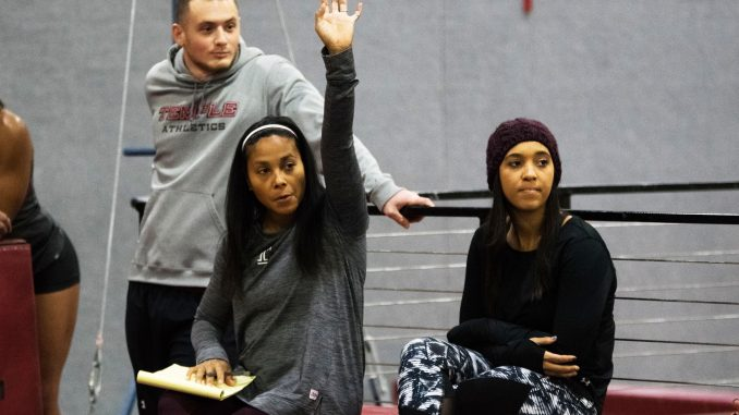 Coach Umme Salim-Beasley (center), assistant coach Michael Rosso (left) and graduate assistant coach Anastasia Halbig work with gymnasts during practice on Wednesday in Pearson Hall. | JAMIE COTTRELL / THE TEMPLE NEWS