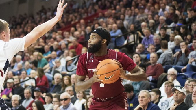Redshirt-senior guard Josh Brown surveys his offensive options during the Owls' 60-51 win against Penn on Saturday at The Palestra. | EVAN EASTERLING / THE TEMPLE NEWS