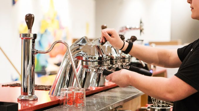 Julia Maass, a senior tourism and hospitality management major, handles an espresso machine in Speakman Hall's student-run Saxbys, which is scheduled to open Wednesday. | SYDNEY SCHAEFER / THE TEMPLE NEWS