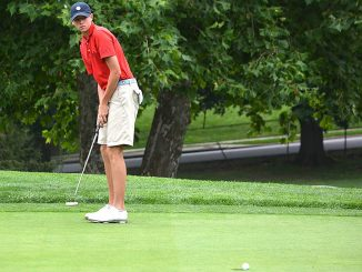 Sophomore Liam McGrath watches his putt on the green at the Joseph H. Patterson Cup Qualifier in August 2016. | COURTESY / CONOR MCGRATH