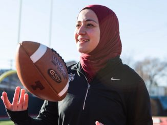 Ameena Soliman, a 2017 finance and marketing alumna, poses at Chodoff Field at 10th and Diamond streets on Sunday. She spent the 2017 season as a graduate assistant in operations and recruiting at Temple and now works at the NFL office in New York City. | SYDNEY SCHAEFER / THE TEMPLE NEWS