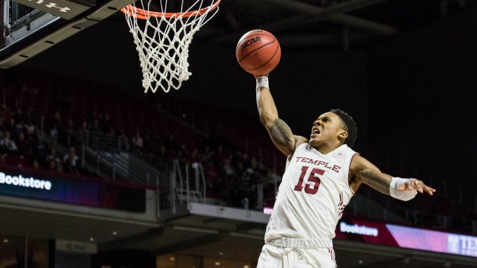 Freshman guard Nate Pierre-Louis dunks on a fastbreak during Temple's 75-72 overtime loss to Memphis on Saturday at the Liacouras Center. | SYDNEY SCHAEFER / THE TEMPLE NEWS