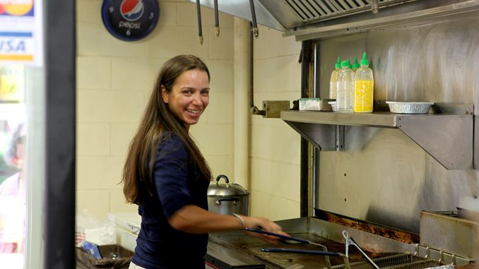 Chef Christina Wilson stands inside Ali's Middle East Food located in the 12th Street Food Pad Vendors. Wilson returns to the stand occasionally to enjoy the food she loved during her time at Temple. ( PAUL KLEIN / TTN )