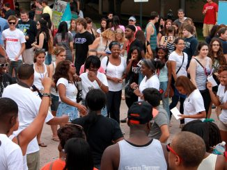 Returning students on Liacouras Walk enjoy Welcome Week activities at TempleFest.