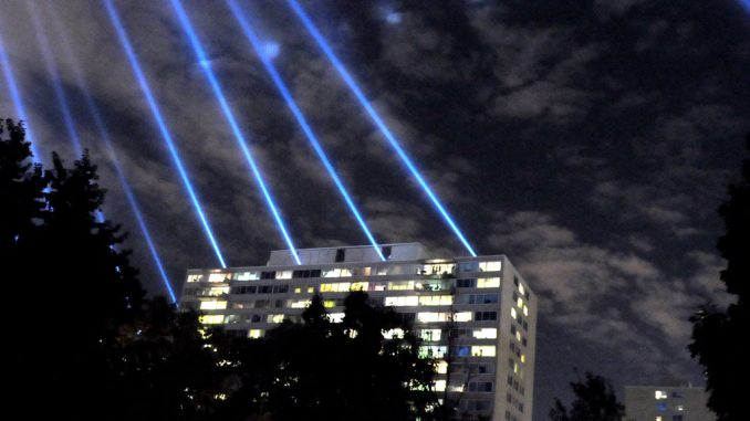 """Beams are projected into the Philadelphia sky as a part of the """"Open Air"""" exhibit. ( ABI REIMOLD // TTN )"""