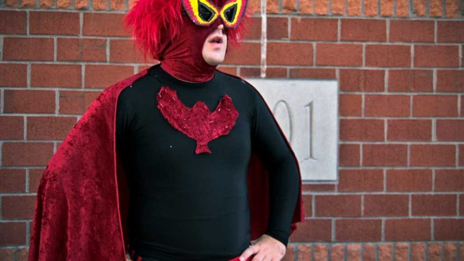 Trevor Flocco manipulates a Batman costume to make his own super hero. ( TIMOTHY VALSHTEIN / TTN )