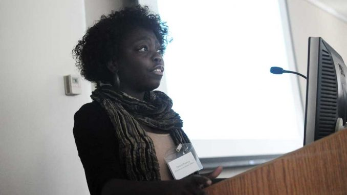 Temple Student Government's Patricia Boateng speaks about issues concerning the general education program at the meeting yesterday, Oct. 22. | ABI REIMOLD / TTN