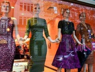 Retro dresses are displayed in the storefront of the newly opened Bettie Page on Walnut Street. | MEAGHAN POGUE / TTN