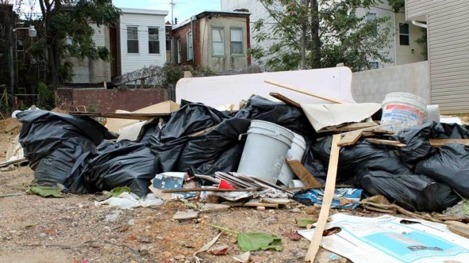 A clutter of trash from construction fills a vacant lot near Main Campus. Last week, a report was released outlining issues with Temple-area construction. ( CINDY STANSBURY | TTN )