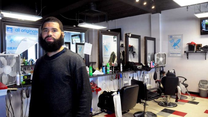 Yusef Beatty, 33, works as a stylist at Mecca Unisex Hair Salon. The salon will be the subject of two MTV reality television shows in the coming months. | ABI REIMOLD / TTN