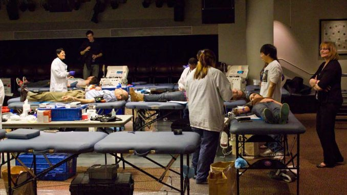 Donors lie down on a table while getting their blood drawn at Keep the Drive Alive on Nov. 21. | LUIS FERNANDO RODRIGUEZ / TTN