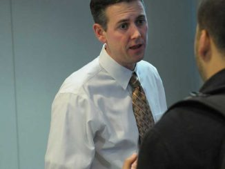Chris Carey of Student Activities discussed a food drive at the TSG meeting Monday. | ABI REIMOLD / TTN