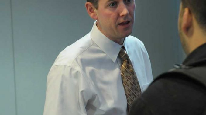 Chris Carey of Student Activities discussed a food drive at the TSG meeting Monday.   ABI REIMOLD / TTN