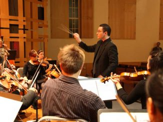 Adam Vidiksis conducts the Temple Composers Orchestra at a dress rehearsal for conTemplum's show on Thursday, Nov. 1. | COURTESY CONTEMPLUM
