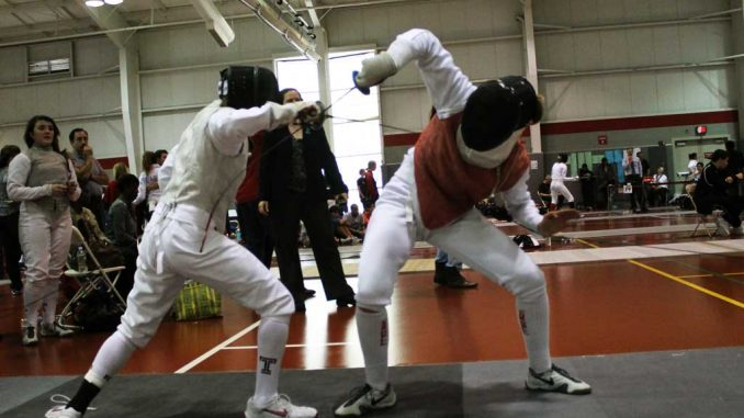 Fencers compete at the Temple Invitational, hosted at McGonigle Hall.   AJA ESPINOSA / TTN