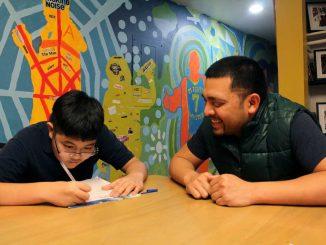 Youth Coordinator James Owk helps Alain Nguyen do his homework at the Mighty Writers center on Oct. 25. | URSZULA PRUCHNIEWSKA / TTN