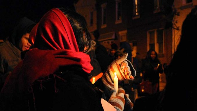 Attendees of a vigil mourn the loss of Stephen Khiry Johnson, a senior who was shot and killed on Jan. 1.   ALI WATKINS TTN