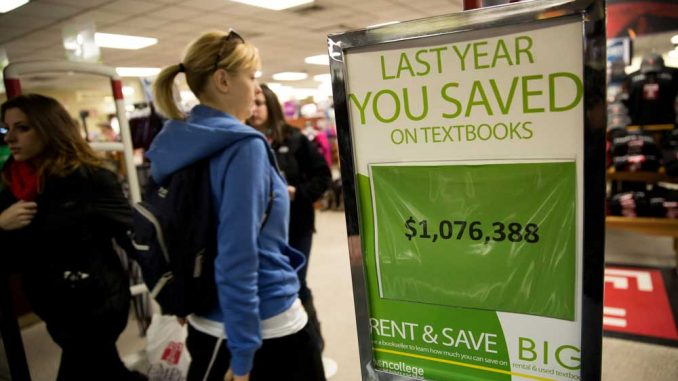 A sign boasts that students saved more than $1 million by renting textbooks last year. Temple's bookstore has the highest rate of textbook rentals.   HUA ZONG / TTN