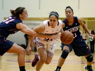 Freshman guard May Dayan (center) drives the lane in a 61-48 win against Richmond on Jan. 31. Dayan is one of five freshmen to receive playing time this season. | MAGGIE TRAPANI / TTN