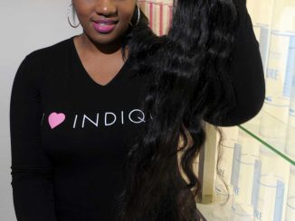 """Indique Boutique manager Maryam Sherif shows off the store's hair options. The store prides itself on offering """"virgin"""" hair, which isn't dyed or chemically altered. 