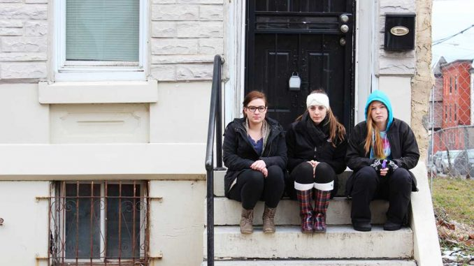 From left, Shaylin Carper, Laura Cuconati and Kati O'Kane sit at their 17th Street off-campus house. | ADDY PETERSON / TTN