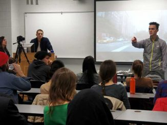 """Alex Melonas, a political science graduate student and interviewee in """"Speciesism: The Movie,"""" discusses the film with students on March 19 in Tuttleman Hall. 