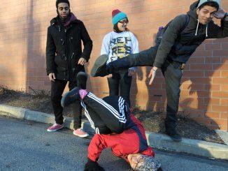 Danzel Thompson-Stout, Bea Martin and Cristian Barreto watch Neha Sharma breakdance outside the TECH Center.   ABI REIMOLD / TTN