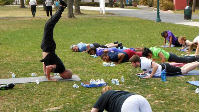 Diamond Dallas Page hosted a free outdoor session of his yoga program at Ambler on April 10. The former professional wrestler is now a professional trainer. | JOHN CORRIGAN / TTN