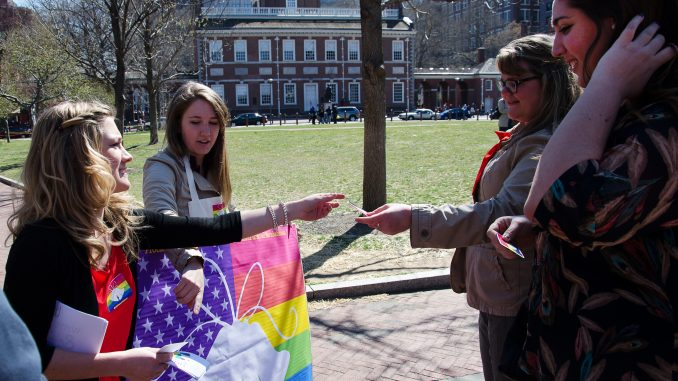 Members of Philly Supports Liberty hand out LGBT rights stickers. | LAURA ORDONEZ / TTN