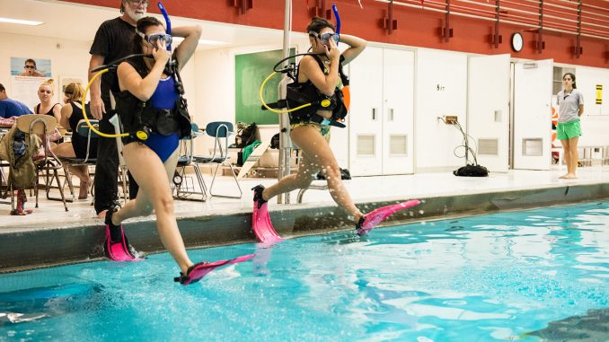 Mike Guckin's scuba class is divided between time in the classroom and the pool. | Eric Dao TTN