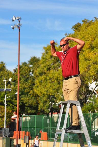 Director of the Temple University Marching Band, Matthew Brunner, conducts Wednesday afternoon band practice on the football field at 16th and Berks Streets. | Jacob Colon TTN