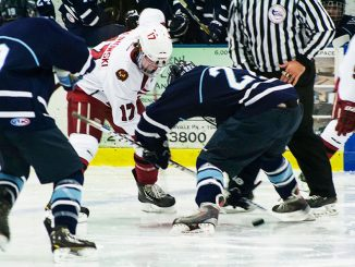 Sophomore Greg Malinowski fights for the puck in a game against Villanova. Malinowski chose to continue playing hockey after losing his nephew, Colden Malinowski, and his friend Alex Sellen. | Patrick McPeak TTN