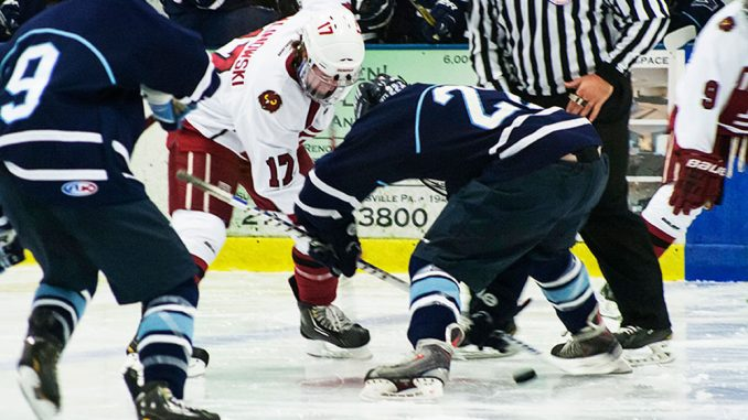Sophomore Greg Malinowski fights for the puck in a game against Villanova. Malinowski chose to continue playing hockey after losing his nephew, Colden Malinowski, and his friend Alex Sellen.   Patrick McPeak TTN