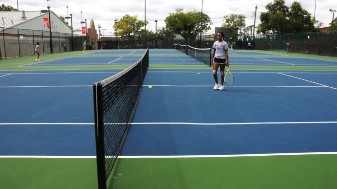 Senior Jordan Batey, of the women's tennis team, retrieves a ball during practice on the recently renovated courts at 15th and Norris streets. | Jacob Colon TTN