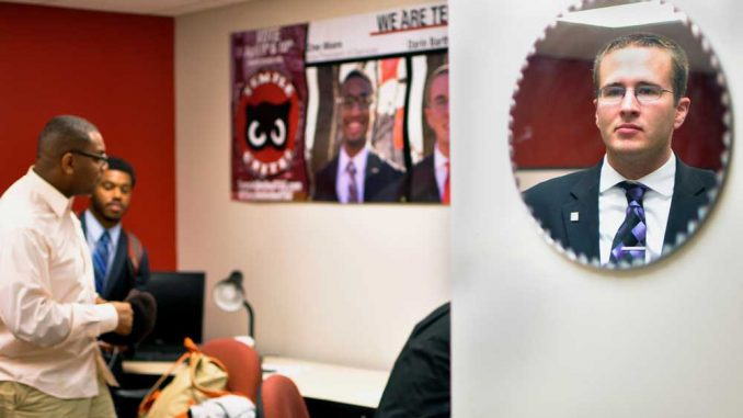 Student Body President Darin Bartholomew looks into an office mirror. Bartholomew led a campaign to register voters in residence halls this semester. | JACOB COLON TTN