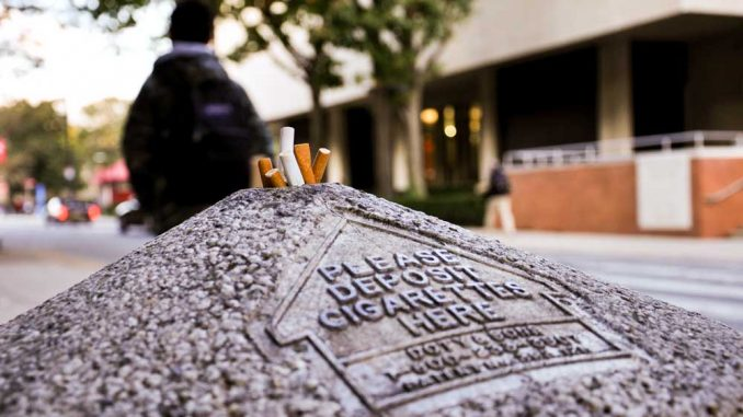 Discarded cigarettes are crammed into an ashtray in front of Speakman Hall. Reflecting a national trend, administrators say the university will consider making Main Campus smoke free as part of the next master plan. | YUXUAN JIA | TTN