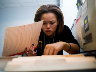Chloe Brown, a sophomore criminal justice major, searches for the file of a client she is assisting with their job search at LIFT North Philadelphia.   Abi Reimold TTN