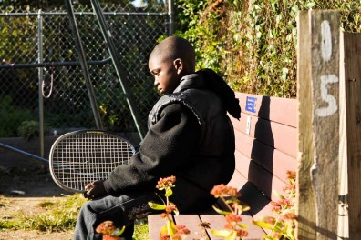 Kevon Lewis sits on a bench in an empty lot-turned garden on West Rockland Street in Germantown. The street is the subject of a community improvement project organized by sisters and street residents Emaleigh and Aine Doley. | JACON COLON TTN