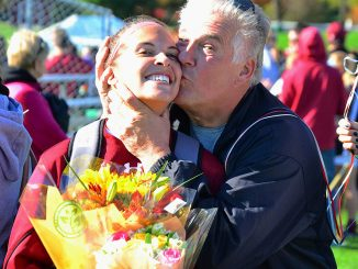 Jackie Krostek's father, Richard, gives his daughter a kiss after Sunday's game against Cincinnati. | Sergei Blair TTN