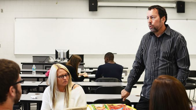 Gregg Feistman used the government shutdown as a topic of debate in his public relations class. | Andrew Thayer TTN