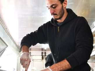 Eddy, an employee at Schmear It, mixes personalized Coldstone-Creamery-style cream cheese for customers. | Skyler Burkhart TTN