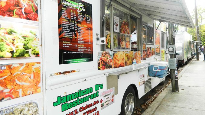 Jamaican D's opened a truck on campus this fall semester. Owner Dave Dawes already operates out of three other trucks and one restaurant in Philadelphia. | Sash Schaeffer TTN