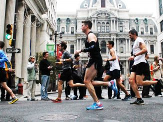 Competitors race by City Hall during the 20th annual Philadelphia Marathon on Sunday, Nov. 17, in which 30,000 participated.   Aja Espinosa TTN