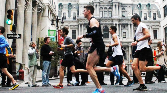 Competitors race by City Hall during the 20th annual Philadelphia Marathon on Sunday, Nov. 17, in which 30,000 participated. | Aja Espinosa TTN
