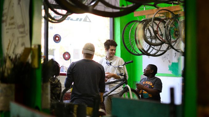 Philadelphia children gathered at Neighborhood Bike Works on Nov. 6 to learn how to repair bikes. Their service hours go towards getting their own bike. | Skyler Burkhart TTN