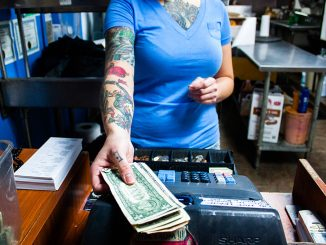 Casey Crawford works at Sketch Burger in Fishtown. She is also an aspiring tattoo artist and has apprenticed at several shops.| Kara Milstein TTN