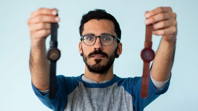 Creator of Analog Watch Co., Lorenzo Buffa, holds prototypes of his watch from the Carpenter Collection at his soon-to-be storefront in South Philly. | Kara Milstein TTN