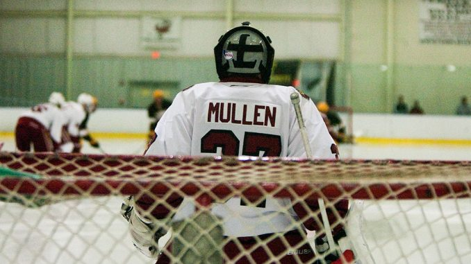 Chris Mullen makes a save during the Owls' 5-2 loss to Rowan on Friday night. Temple's defense has given up high shot totals during early season competition.   Paul Klein TTN